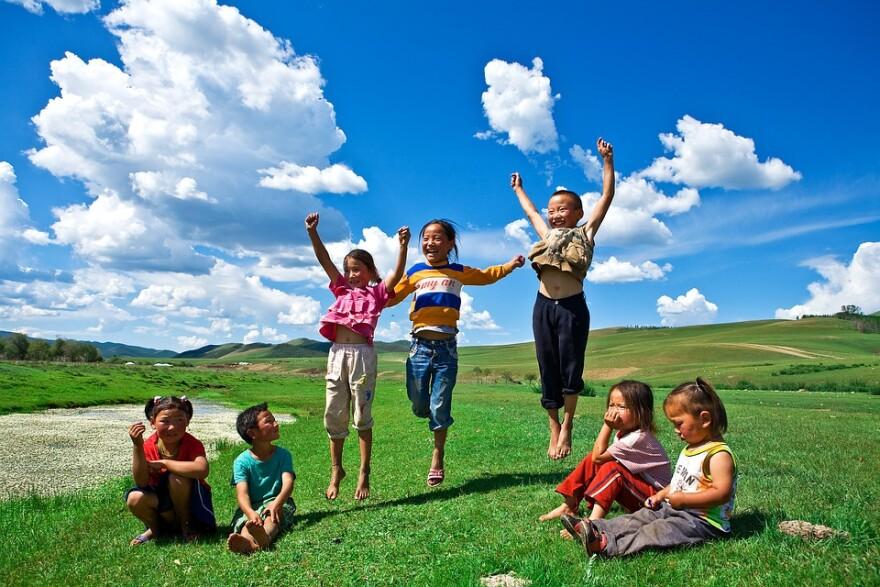 kids_playing_grass_sky.jpg