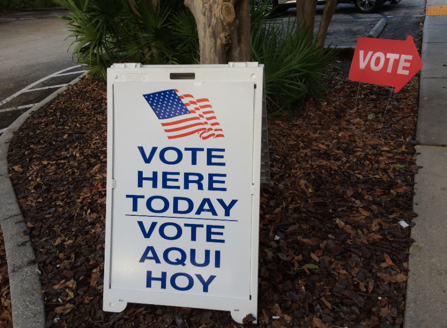 A sign that says vote here today