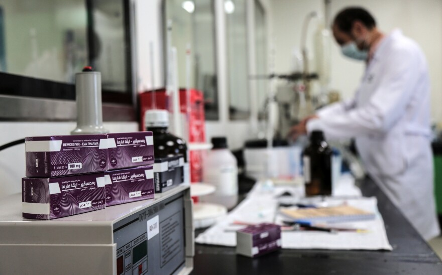 Boxes containing vials of remdesivir at a pharmaceutical company in Giza, Egypt.