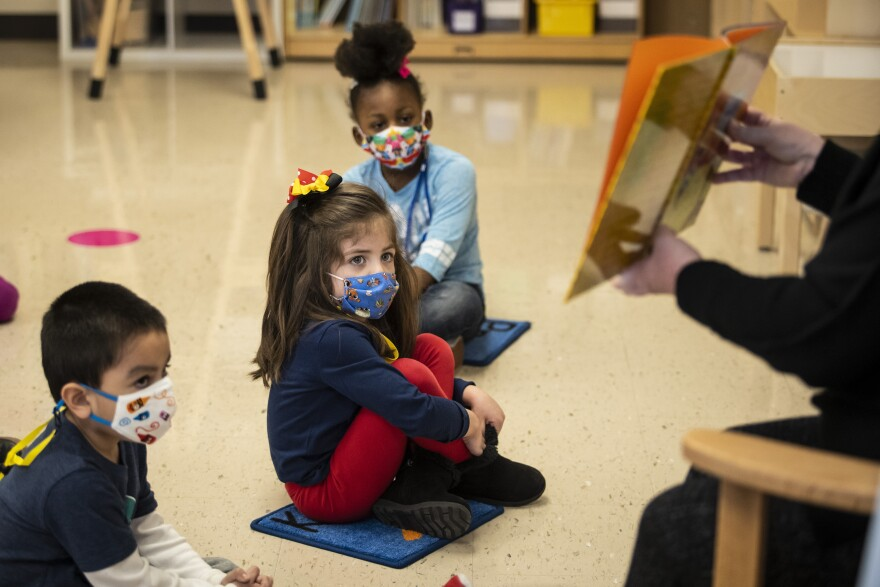 Pre-kindergarten students listen as their teacher reads a story at Dawes Elementary School in Chicago on Jan. 11.