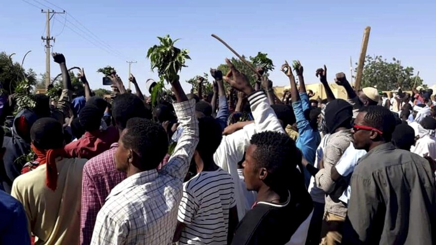 People protest in the Sudanese city of Kordofan on Dec. 23, days after demonstrations first broke out in the country. Protesters have continued to gather for more than two weeks, calling for the ouster of President Omar al-Bashir.