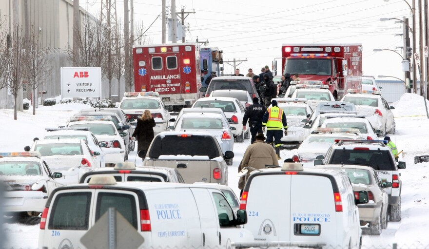 Dozens of law enforcement vehicles line Bircher Blvd., outside ABB's complex, on Jan. 7, 2010. A disgruntled employee had shot and killed three people and wounded five others before turning the gun on himself.