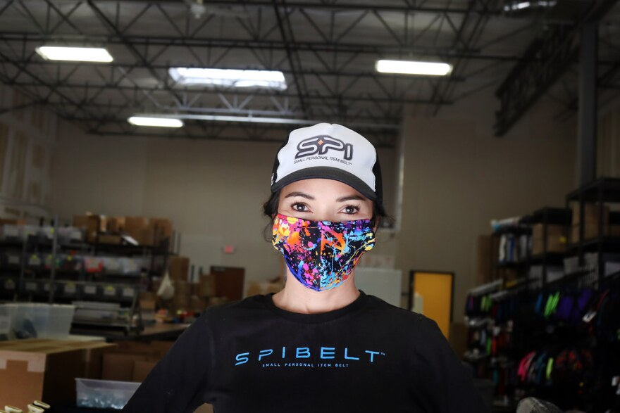 SPIbelt Founder Kim Overton wears one of the fabric face masks her company has started making since the coronavirus outbreak.
