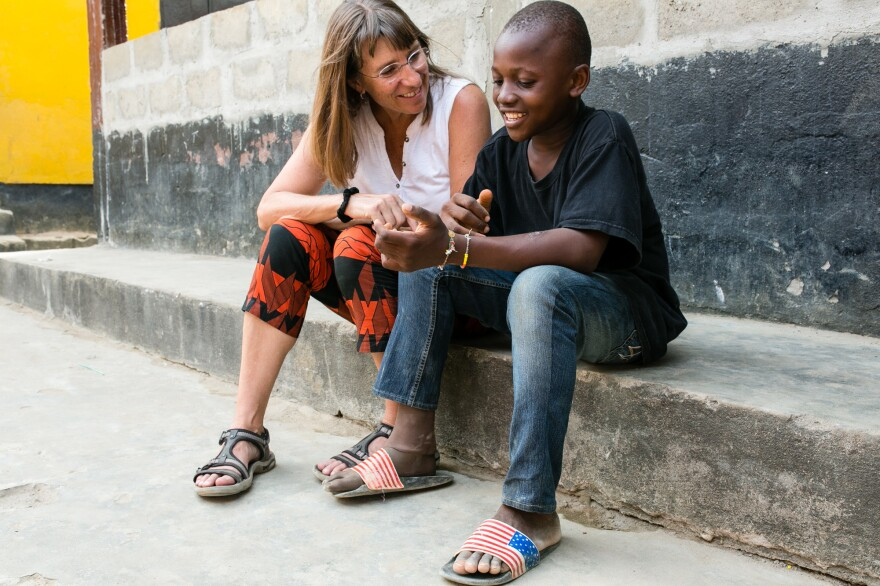 "Peace Corps volunteer Anne Goreski chats with Sundaygar. Says Goreski: ""He's a kid who knows how to make things happen."""