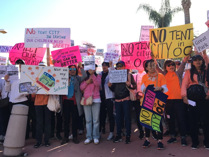 Protesters arrived in chartered buses to fight a plan by Orange County to relocate homeless people from Santa Ana to new temporary shelters in more affluent coastal cities.