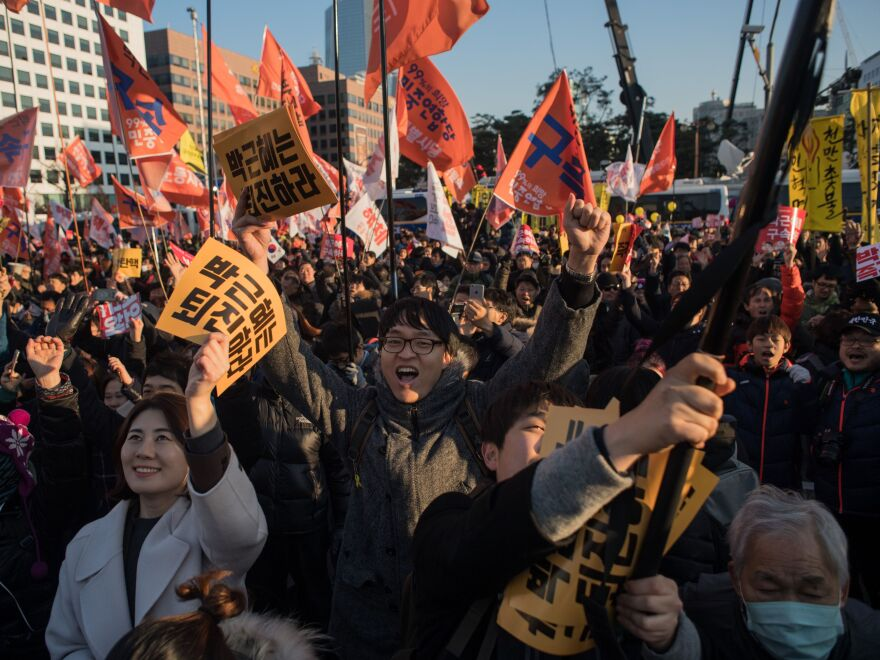 Demonstrators celebrate after the South Korean Parliament voted to impeach President Park Geun-Hye, as huge crowds gathered outside the National Assembly in Seoul on Friday.