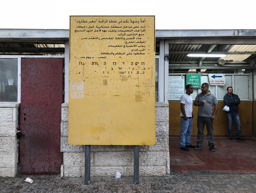Palestinians go through an Israeli checkpoint at the Israeli separation barrier, which cuts through some neighborhoods of East Jerusalem.