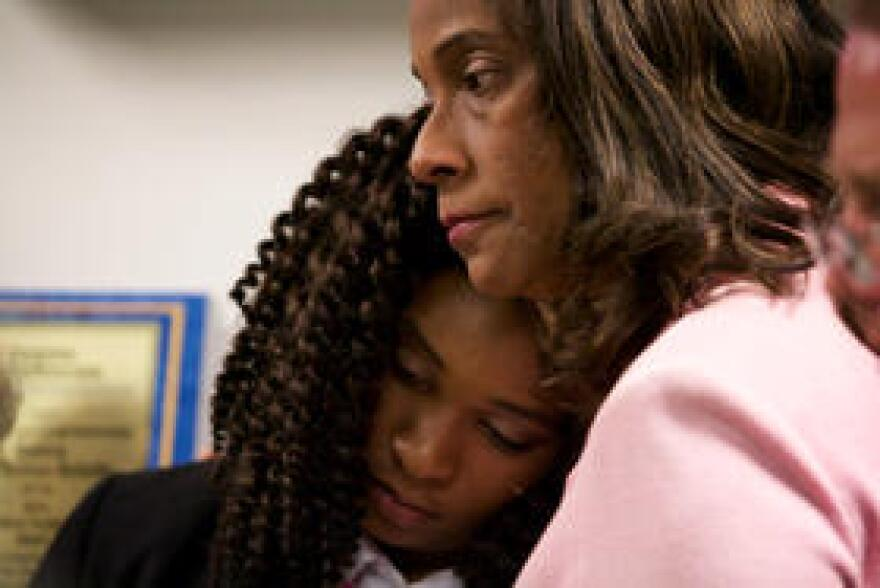Broward County School Board member Dr. Rosalind Osgood hugs Marjory Stoneman Douglas High School student Mei-Ling Ho-Shing at a news conference in Sunrise on Mar. 5, 2018.