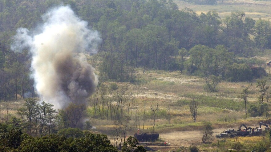 Smoke rises after South Korean soldiers set a blast to remove land mines in the Demilitarized Zone in 2002. The Korean Peninsula had been the last region the U.S. military was allowed to use the weapon — until Friday, when the Trump administration lifted the Obama-era restriction.