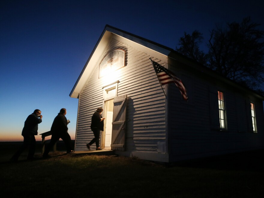 Voters enter a polling place at dusk to cast their ballots at Sherman Township Hall, a former one room schoolhouse, on November 3, 2020 in Zearing, Iowa.