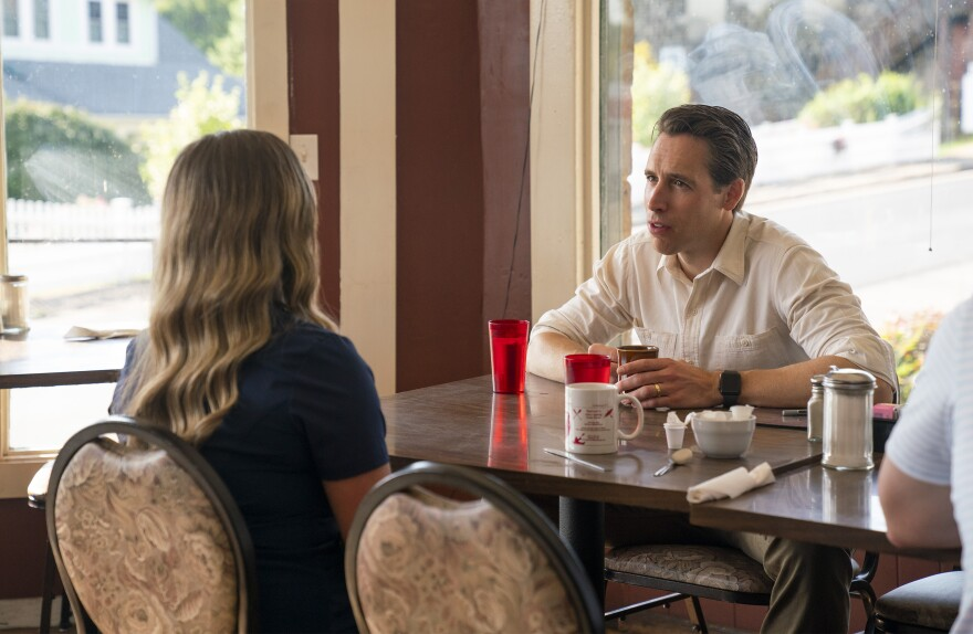 U.S. Sen. Josh Hawley spent last week touring 10 rural Missouri counties. This photo supplied by his staff features the Republican senator talking to a woman in Eminence, Missouri.
