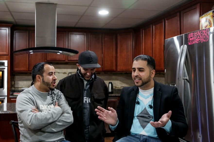 (Left to right) Yunus Wasel, Salah Hadwan and Nabil Nagi talk about their ties to Michigan and The Big Three car companies.