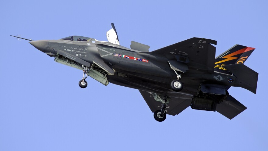 """A Marine Corps F-35B Joint Strike Fighter does a short takeoff (STOVL) from Patuxent River Naval Air Station, Md., in 2011. Eighteen years after development began, a version of the plane designed for the Marine Corps is expected to be deemed """"combat ready."""""""