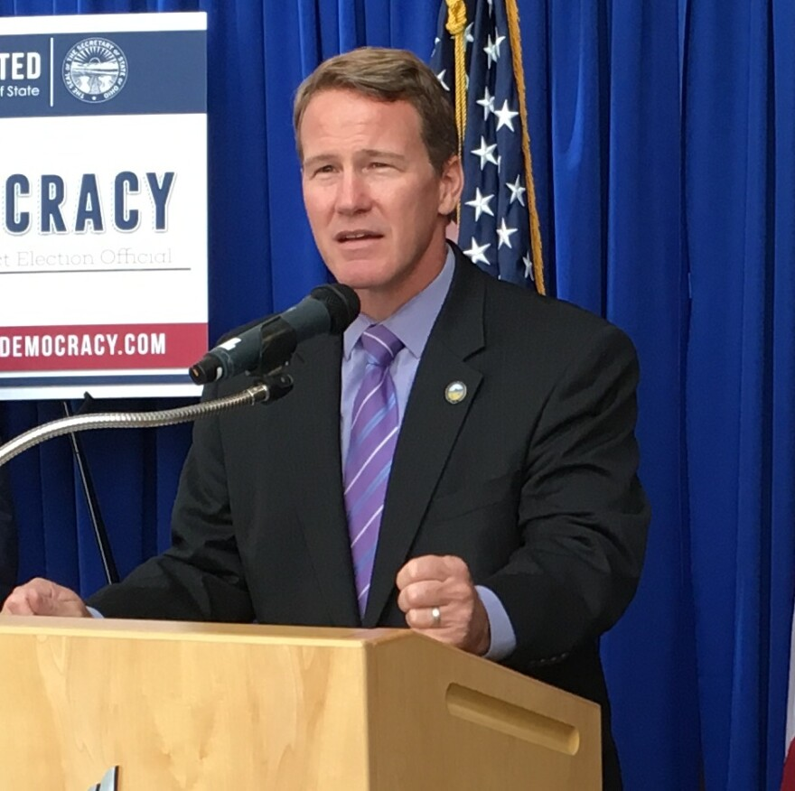 John Husted stands at a podium at a 2016 event