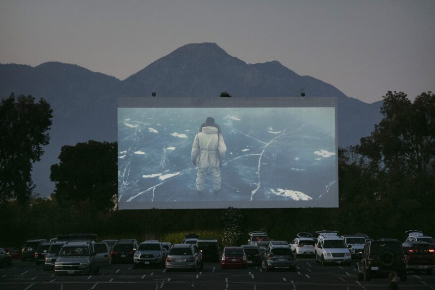 Moviegoers watch a preview in their socially distanced vehicles at Mission Tiki drive-in theater in Montclair, Calif., Thursday, May 28, 2020. California moved to further relax its coronavirus restrictions and help the battered economy. (Jae C. Hong/AP Photo)