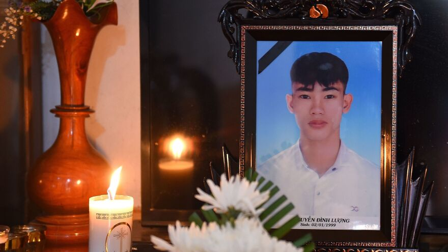 Nguyen Dinh Luong, 20, seen in a portrait placed on a prayer altar at his house in Vietnam, was among the 39 migrants who died in the truck's trailer last month.