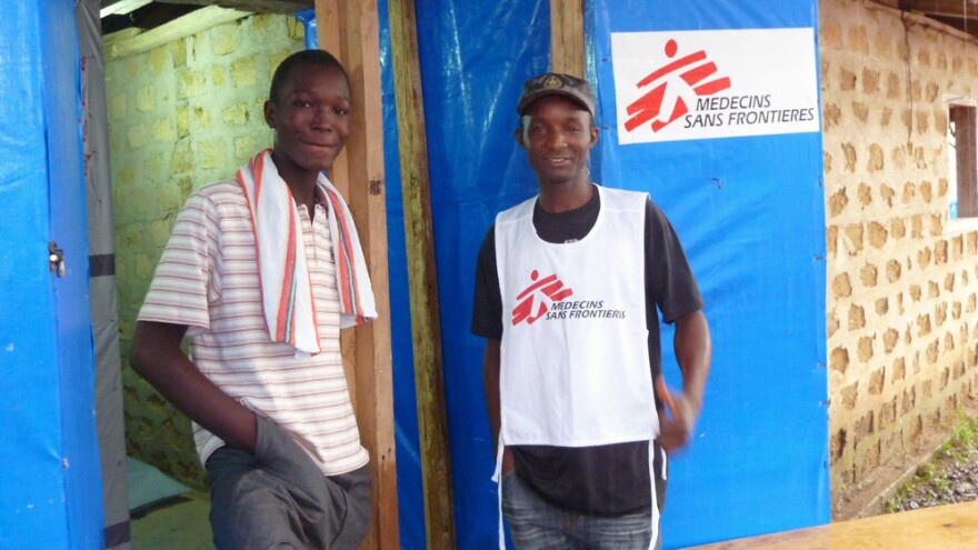After losing most of his family to Ebola, health worker Alexander Kollie (right) is building a new life with son Kollie James, the 1,000th survivor of the disease to be cared for by Doctors Without Borders.