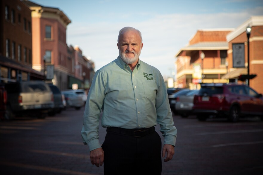 """Fort Scott, Kan., City Manager Dave Martin stands in the middle of the city's historic main street. """"We really thought that we had a relationship,"""" says Martin, who is angry about Mercy's decision to close the hospital."""