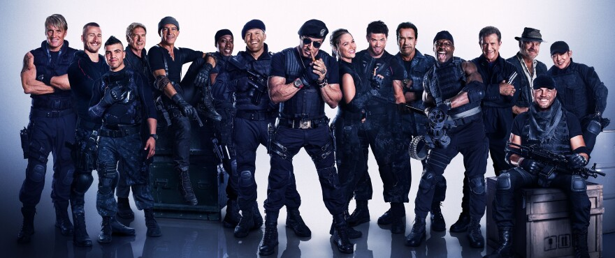 The Expendables are back with enough male movie stars in black to go around. It's possible some of your relatives are in this picture.