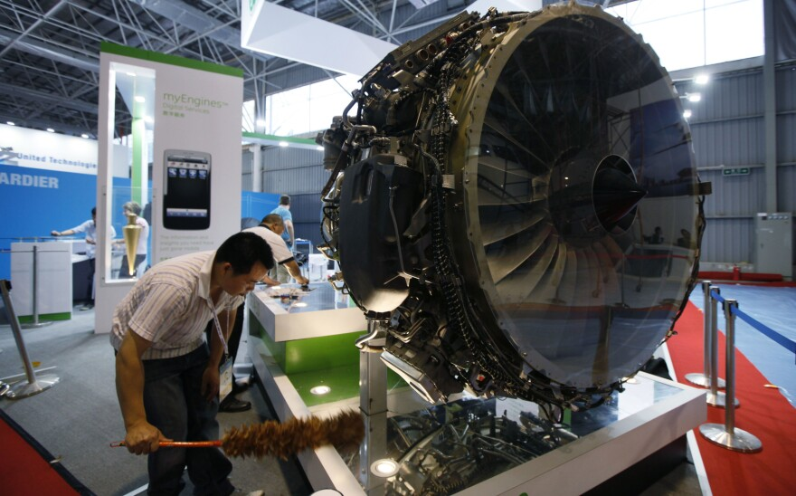 GE Aviation exhibited equipment at the Zhuhai Airshow in 2010. Now, U.S. officials say, a Chinese intelligence officer has been charged with trying to steal American jet engine technology.
