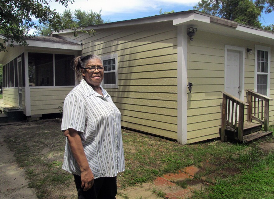 Mississippi resident Ethel Curry stands in front of her East Biloxi home, which was rebuilt with the help of volunteers after Hurricane Katrina.