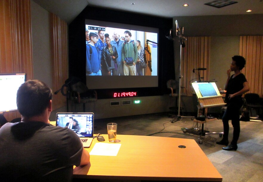 Supervising sound editor Rob Nokes (left) and looper Lanei Chapman watch a silent scene to get a sense of what to say during a looping session for the television show <em>Bones</em>.