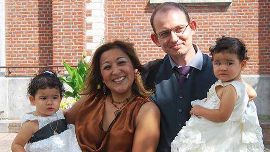A 2013 photo of Adelma Tapia Ruiz, provided by her brother Fernando Tapia Ruiz, shows Ruiz with her Belgian husband, Christophe Delcambe, and their twin daughters, Maureen and Alondra. Ruiz died in Tuesday's attacks. A split-second decision saved her husband and daughters from sharing her fate: Delcambe had taken the girls out of the check-in line to play for a moment when the bomb exploded.