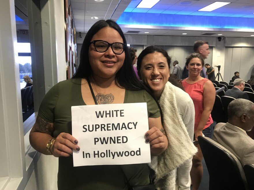 Hollywood Residents quietly took pictures with signs in support of the name change.