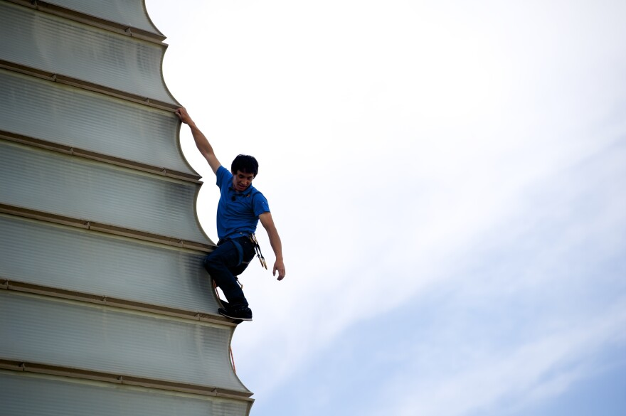 Austrian climber David Lama climbing the Kursaal building during the 2013 San Sebastian International Film Festival in San Sebastian, Spain.