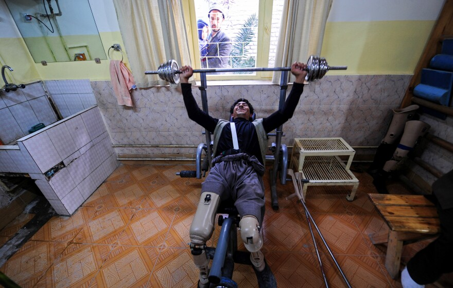 An Afghan amputee lifts weights at the International Committee of the Red Cross facility for war victims and the disabled in Mazar-i-Sharif. In September, a patient shot and killed a staffer, closing the center for a month and contributing to a decision to scale back operations in the country.