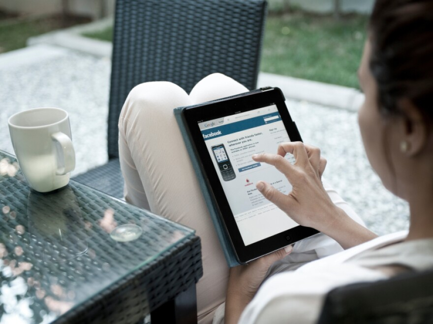 A woman uses a tablet computer.