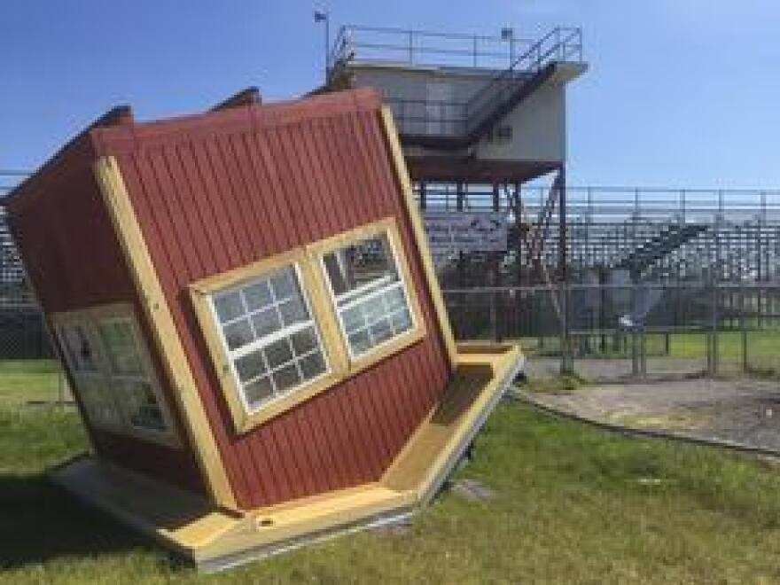 At Liberty County High, the booth to call games at Bulldog Field was blown off its tower and sitting behind the bleachers following Hurricane Michael.