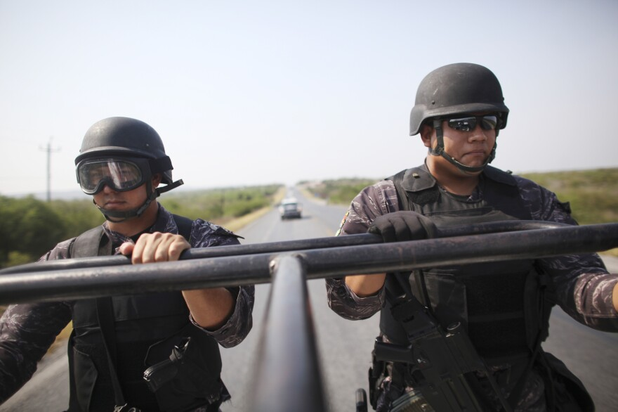 State police officers patrol a highway between Ciudad Victoria and Matamoros, in northeast Mexico, in 2011. Mexico's drug and turf wars have descended on the once tourist friendly border town of Matamoros.