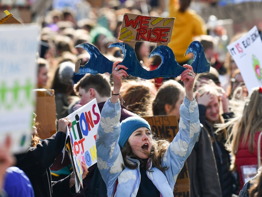 School children hold placards and shout slogans at a protest in Edinburgh, Scotland. Students around the world took to the streets to protest a lack of climate awareness and demand that elected officials take action on climate change.