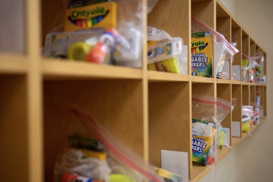 School supplies stored in cubbies in a classroom.