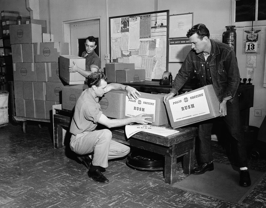 In the shipping room at Cutter Laboratories in Berkeley, Calif., workmen label packages of Salk polio vaccine.