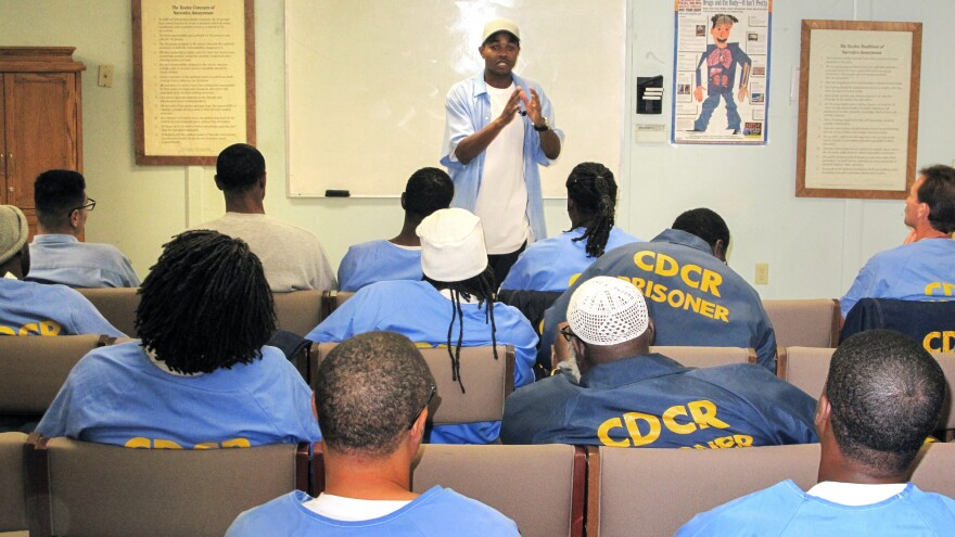 """Known by the nickname """"Wall Street,"""" Curtis Carroll teaches financial literacy at the San Quentin Prison, helping inmates prepare for life after incarceration. Carroll, however, is serving a life sentence."""