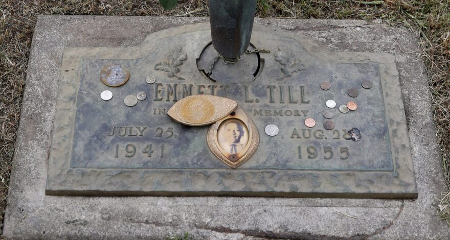 In this Aug. 28, 2015 file photo, the grave marker of Emmett Till has a photo of Till and coins placed on it during a gravesite ceremony at the Burr Oak Cemetery marking the 60th anniversary of the murder of Till in Mississippi, in Alsip, Ill.   The woman at the center of the trial of Emmett Till's alleged killers has acknowledged that she falsely testified he made physical and verbal threats, according to a new book. Historian Timothy B. Tyson told The Associated Press on Saturday, Jan. 28, 2017,  that Carolyn Donham broke her long public silence in an interview with him in 2008. (Charles Rex Arbogast/AP)