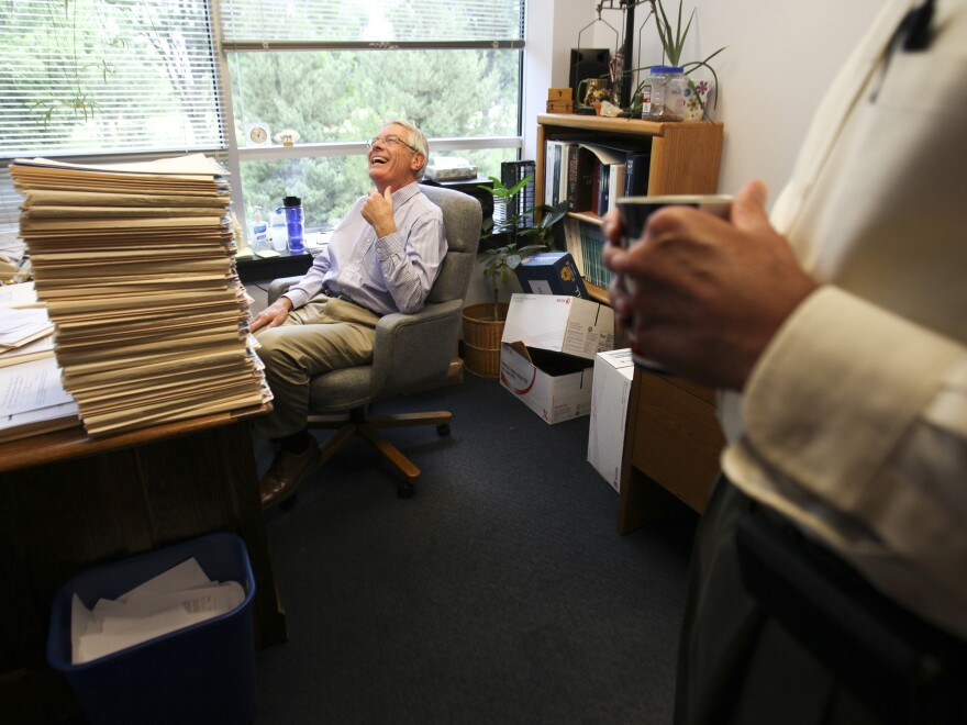 Dr. Michael Spangler, who has been practicing medicine for 40 years, is happy using paper records. He isn't convinced that going digital will be an improvement.