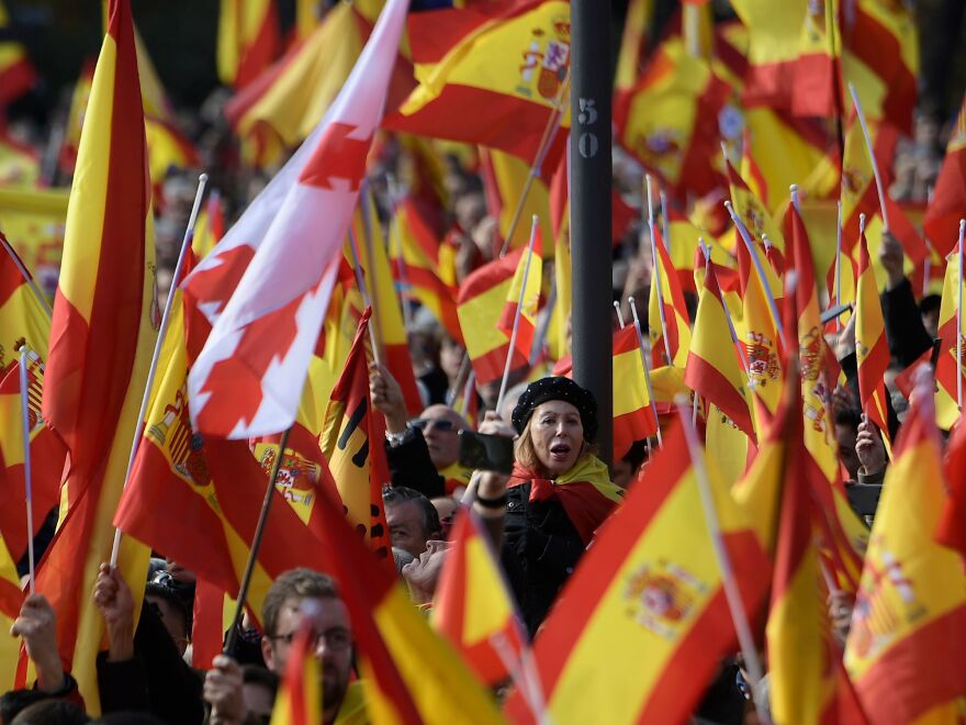 People hold Spanish flags during a demonstration called by the far-right Vox Party, over the weekend in Madrid. On Sunday, the once-derided party claimed 12 seats Andalusia's regional elections.