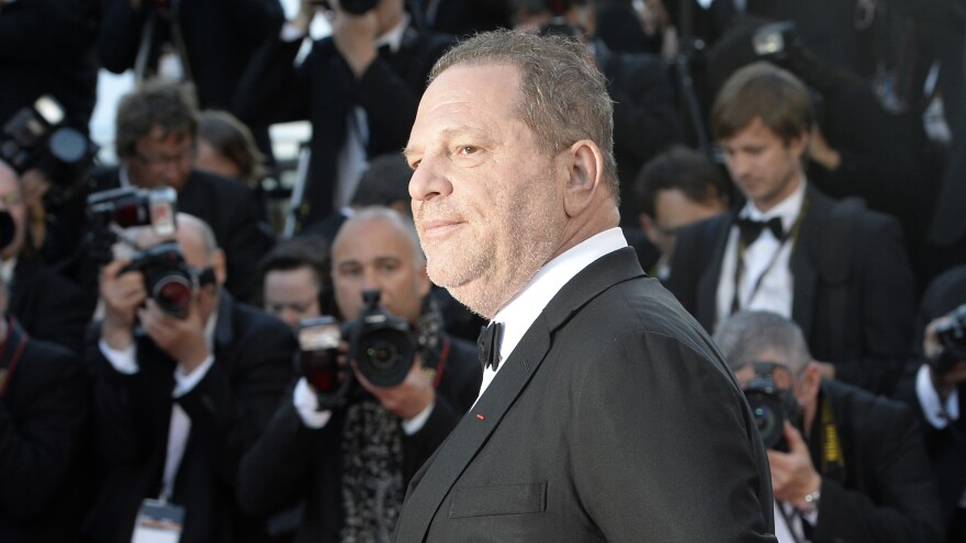 Harvey Weinstein poses on the red carpet of the 2013 Cannes Film Festival. Weinstein is the subject of numerous allegations of sexual harassment spanning decades.