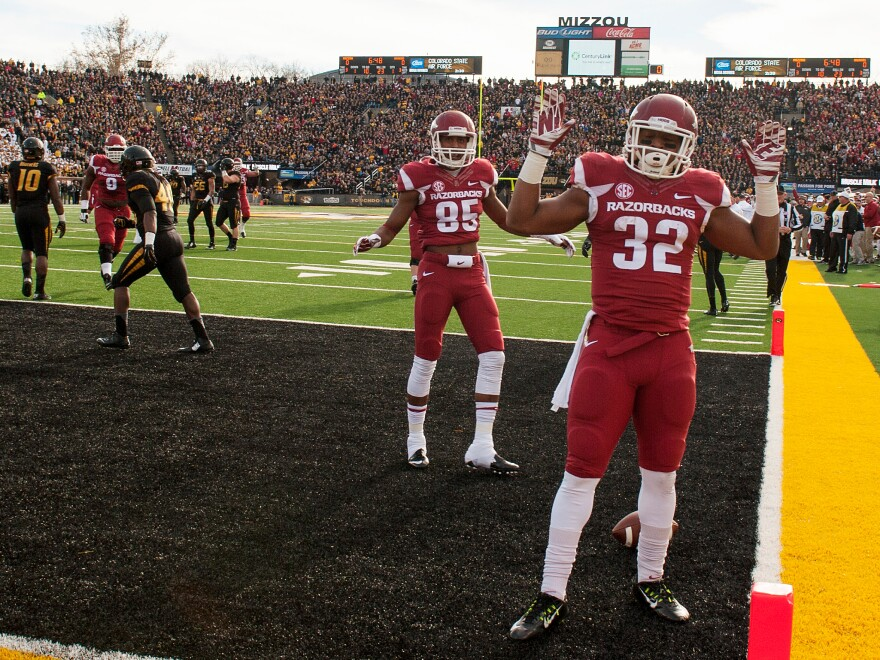 "Arkansas running back Jonathan Williams had just scored a touchdown against Missouri last season when he dropped the ball and raised his hands in a hands up, don't shoot"" gesture."