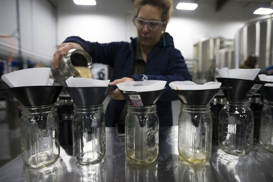 Andrea Stanley of Valley Malt in Hadley, Mass., steeps small amounts of malt as part of the international Pink Boots Collaboration Brew Day, an event meant to highlight women's growing influence on the beer industry.