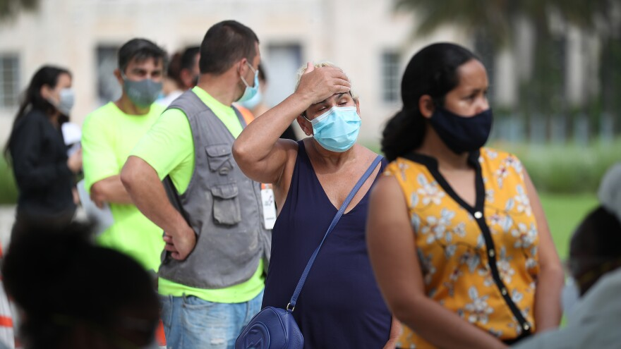Carmen Garcia stands in line on Friday to be tested for COVID-19 at a Mobile Testing Truck in Miami Beach, Fla. The units were brought to the area as the cases of coronavirus spike in Florida.