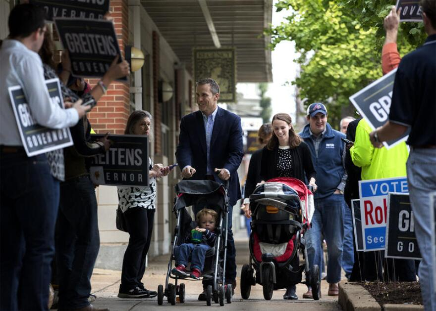 Gov. Eric Greitens and his wife, Sheena, brought their two children to a polling place before the November general election. Greitens signed an executive order extending paid parental leave for some state employees.