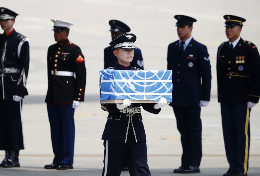A soldier carries a casket containing possible remains of a U.S. soldier who was killed in the Korean War during a ceremony at Osan Air Base in Pyeongtaek, South Korea, Friday.