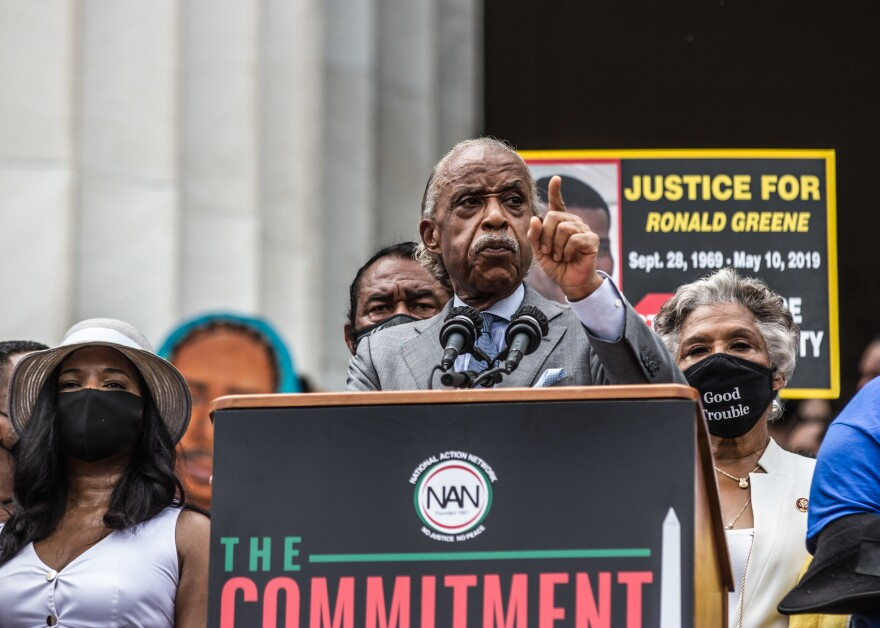 The Rev. Al Sharpton said, 'We didn't come out and stand in this heat because we didn't have nothing to do. We come to let you know, if we will come out by these numbers in the heat ... that we will stand in the polls all day long.'