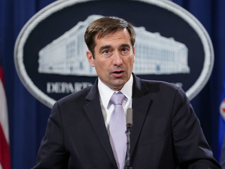 John Demers, assistant attorney general for national security, announces a law enforcement case involving China in November 2018. The Justice Department is prosecuting more alleged cybercrime cases.