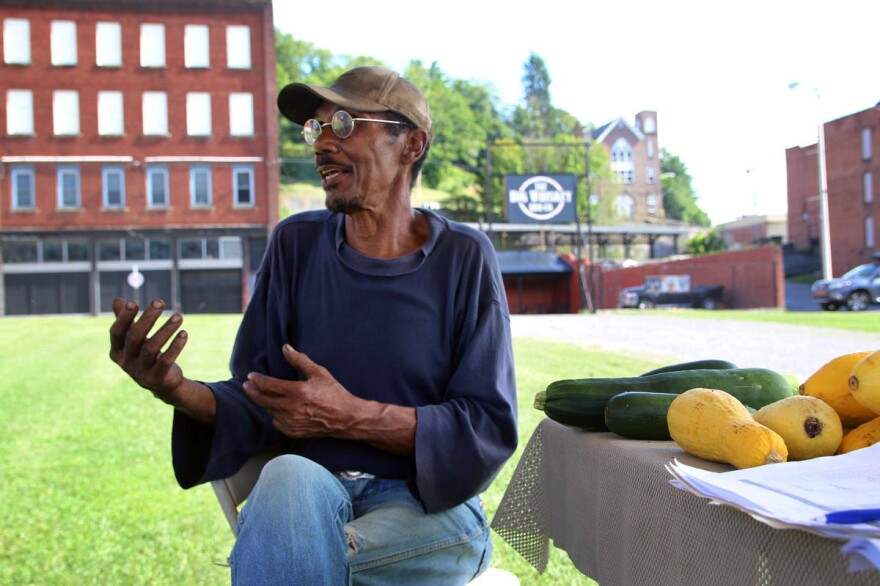 Farmer Sky Edwards has tried to start a farmers market in McDowell County, W.Va., but so far it hasn't been successful. So he travels 60 miles round trip each week to sell vegetables in Bluefield, W.Va., where residents have more cash to spend on groceries.