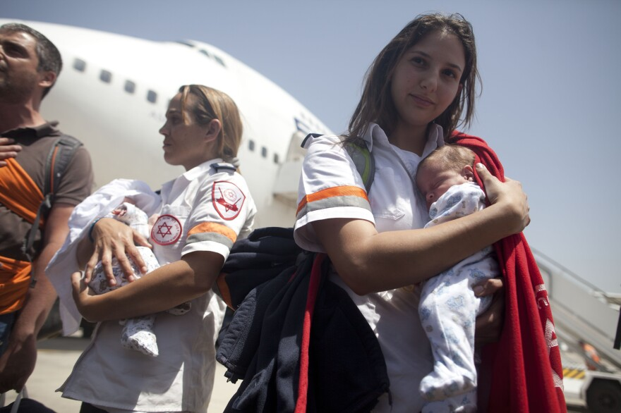 These babies just arrived in Israel from Nepal, where they were born to surrogate mothers. A plane carrying 229 Israelis, including newborns, landed at Ben-Gurion International Airport on Tuesday afternoon.